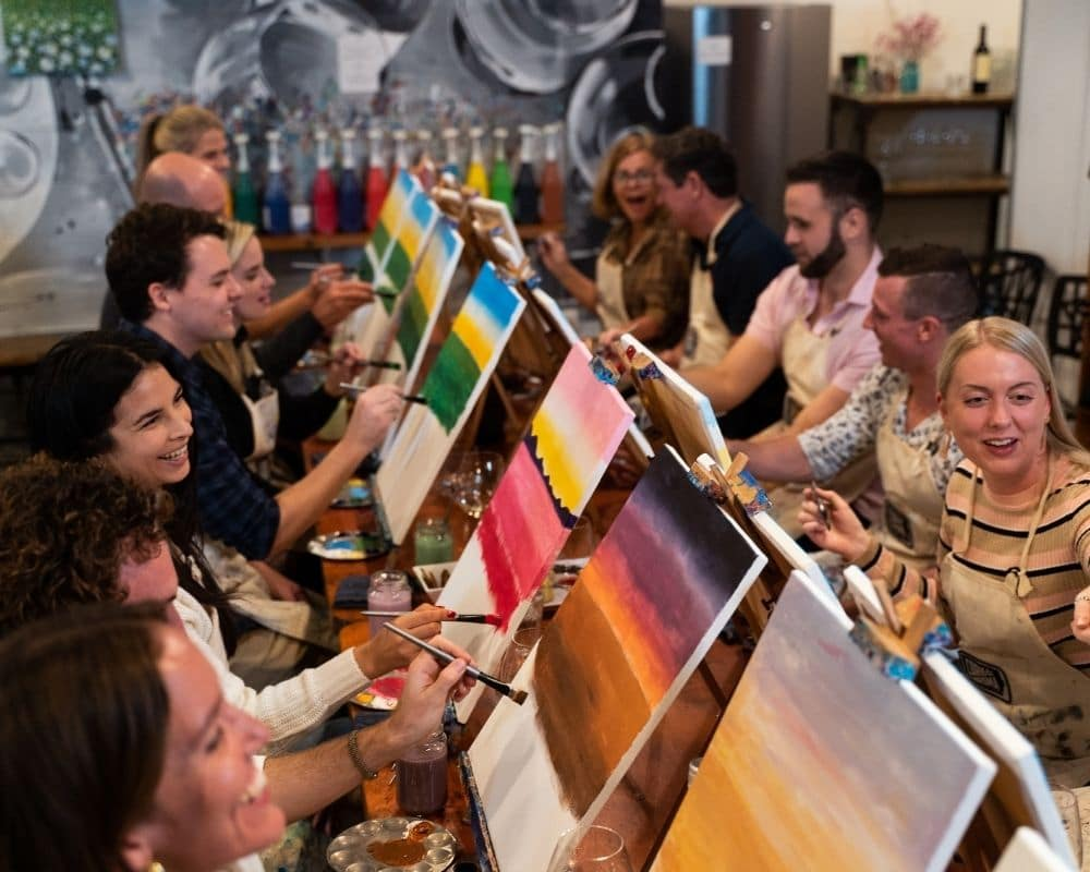 Large group painting together at Cork & Chroma Brisbane